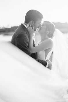 Bride, Morgan's veil sweeping in the wind Photo: @amymulderphotography