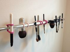 Very smart way to hang makeup brushes after washing...