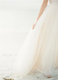 For a summer wedding, keep gowns airy and light using fabric like tulle Photography: KT Merry Photography - ktmerry.com  View entire slideshow: Beat the Summer Heat on http://www.stylemepretty.com/collection/395/
