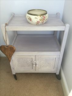 1950's dark wood tea trolley made over as a bedroom cupboard