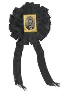 1865 Abraham Lincoln memorial ribbon. The most sought-after president in terms of collectibles, Abraham Lincoln continues to captivate Americans' imaginations. This memorial ribbon—with a ferrotype of Honest Abe encased in a brass gem frame and set in a somber black silk rosette—was likely worn by one of the thousands of mourners following Lincoln's assassination at Ford's Theatre in 1865.