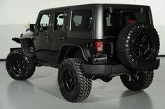 Custom Black Clearcoated 2014 Jeep Wrangler Unlimited: Rear-Side View