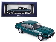 "1986 Ford Capri 280 ""Brooklands"" Green Metallic Limited Edition to 1038pcs 1/18 Diecast Model Car by Norev - Brand new 1:18 scale diecast car model of 1986 Ford Capri 280 ""Brooklands"" Green Metallic Limited Edition to 1038pcs by Norev. Brand new box. Rubber tires. Has opening hood, doors and trunk. Made of diecast with some plastic parts. Detailed interior, exterior, engine compartment. Dimensions approximately L-10, W-4, H-3.5 inches.-Weight: 4. Height: 8. Width: 15. Box Weight: 4. Box…"