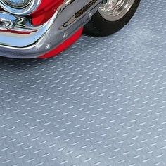 8 Easy and Affordable Garage Floor Options - - It's hard to find garage floor ideas that can stand up to the daily wear and tear that takes place in this space. Here are some of the best options to consider, at any price point. Rubber Garage Flooring, Garage Flooring Options, Garage Floor Mats, Garage Floor Paint, Inexpensive Flooring, Diy Flooring, Bedroom Flooring, Flooring Ideas, Basement Flooring