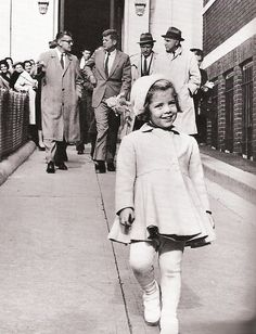 Caroline Kennedy with her dad carrying her doll, Sassafras.