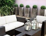 Nice outdoor decor (especially the silver planters)