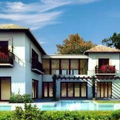 Casa Yucatan Country Club- Boué Arquitectos : Casas de estilo rústico por Boué Arquitectos