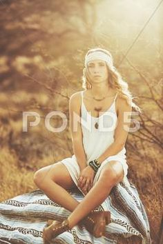 Stock photo Fashion Lifestyle. Fashion Portrait of Beautiful Young Woman Outdoors. Soft warm vintage color tone. Artsy Bohemian Style..  9.9 MB. 3840 x 5760. From $10. Royalty free. Download now >>>