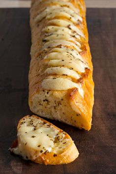 The secret to the best-ever garlic bread? Just spread slices of French bread with a butter mixture and add slices of cheese before baking. This cheesy garlic br