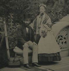 C. 1860 photo of a man and woman posing on Bow Bridge in Central Park, New York.