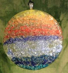 REDEEMED Glass By Kim -Sun catcher created from a melted bottom of a bottle, hand painted with crushed glass fused together