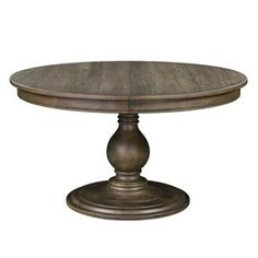 This single pedestal round dining table provides fashion and function to the dining area of your home. Comfortably seat four around the table or choose to extend it to more of an oval shape with the middle 12 inch leaf. The single pedestal boasts powerful turns and is wide in scale. This table is a way to have a dining piece that is sophisticated and inviting while also not taking up a lot of room in your kitchen or dining room.