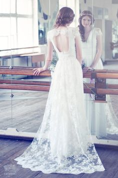 Lace and silk wedding dress with a train // by CarouselFashion
