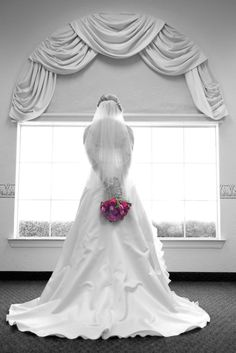 Back Of Bride Looking Out Window