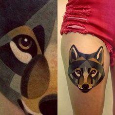 Geometric watercolor wolf tattoo on leg. looks like the art of Sasha Unisex  http://tattoomagz.com/wolfs-tattoos-on-legs/watercolor-lovely-wolf-tattoo-on-leg/