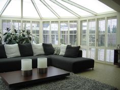 Finish off the stylish lines of a conservatory with made to measure shutters from S:CRAFT.