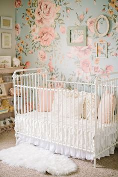 an iron crib, floral wallpaper and sweet vintage details in this baby girl's nursery  Photographer : Corrina Walker Photography Read More on SMP: http://www.stylemepretty.com/living/2016/11/09/tour-the-sweetest-vintage-nursery/