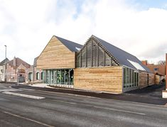 french studio bplusb architectures has extended the 'dainville library' with a pitched, barn roof addition. Library Architecture, Roof Architecture, Minimalist Architecture, Contemporary Architecture, Amazing Architecture, Architecture Details, Modern Library, Library Design, Gable Roof Design