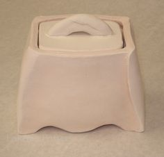 ceramic sugar conainer with lid -- I like the wrap on the right leg..