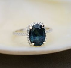 This unique ring features huge 2.9ct blue green sapphire. The color is deep and beautiful. Very intriguing. The sapphire displays a color change