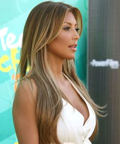 Light brown Hair with Blonde Highlights. Not a fan of her but I love this hair color!