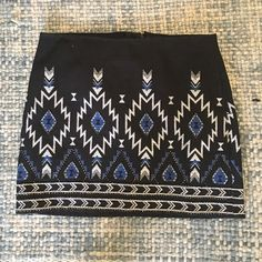 H&M divided beaded mini skirt H&m divided beaded mini skirt fully lined with black shimmery beads and Aztec print us8, eur38 runs small (I'm generally a size 26/4) Divided Skirts Mini
