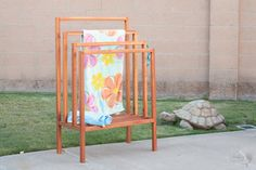 Easy DIY outdoor towel rack or poolside clothes drying rack made from wood. Get the detailed tutorial , plans and video! #anikasdiylife
