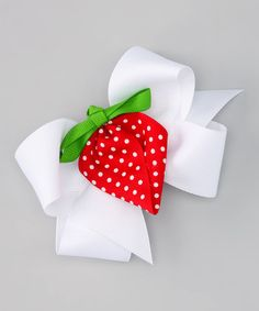 With ribbons wrapped into a bow and a strawberry at the center, this hair flair is perfect for a little shortcake.Includes two clipsBow: 5'' W100% polyesterMade in the USA