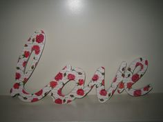 Pink roses on the word LOVE with decoupage technique