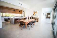 Red Tail Homes Sleek Concrete Kitchen Concrete Kitchen, Kitchen Flooring, Kitchen Trends, Concrete Tiles Kitchen, House Flooring, Kitchen Countertops, New Kitchen, Home Kitchens, Concrete Kitchen Floor