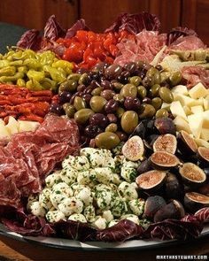 Antipasto comprised of herbed bocconcini, figs, artichoke hearts, cheeses, cured meats, mix of olives, mix of peppers, and breadsticks for serving // i have made this platter several times for big holiday starters, and it has been hugely impressive every This will be something I will make for the super bowl party.
