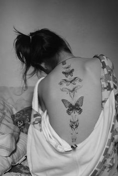 Butterfly tattoo down the spine!  butterflies represent change.... as women age, i beiieve we grow into ourselves. we develop our true persona and are a lot more accepting of  who we've become.