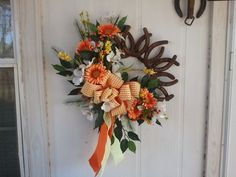Horseshoe Wreath with Florals, i would do this with roses of course