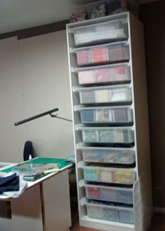 IKEA storage system.. If drawers are at least 12x12 may work great for paper storage