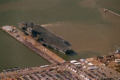USS America-Returned from it's last deployment. It was sunk off the coast of North Carolina to be used as a natural reef. Navy Military, Military Photos, Uss America, Navy Aircraft Carrier, Go Navy, Us Navy Ships, Naval History, Sailing Ships, History Pics