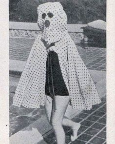 """The #freckleproofcape with built-in sunglasses 😆 """"Floridians who fear freckles have adopted this odd hooded cape. Made of a polka-dot print fabric, the frecklecape has an attached hood equipped with built-in sun glasses to further protect the wearer from the effects of strong sunlight."""" . . (Florida, 1940s) . 📸: Unknown. Contact me for credits."""