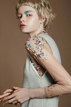 Blue eyeshadow, dewy skin and a blonde short wig used Katja Maaßen for the fashion editorial for sickymag shot by Nicole Franke