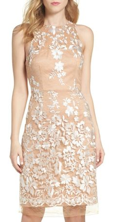 lace midi dress by Betsey Johnson. Pale, embroidered lace skims the fitted silhouette of this elegant cocktail sheath.