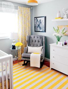A soft grey rocker with bright yellow stripes make this nursery anything but babyish.