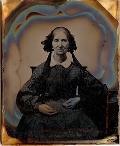Elizabeth Dodge Bronson (1799-1867), a widow in second stage of mourning.  Her daughter Charlotte died at the age of 24, probably of tuberculosis in 1856 and her husband died in 1857. 1/9th-Plate Ruby Ambrotype, circa  1858.