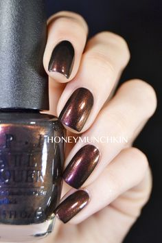 Muir Muir on the Wall is a dark, vampy duochromatic polish, shifting from warm purple to dark gold (to green in some lights). I was expecting a stronger duochromatic effect on the nail, since it's ...
