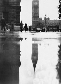 big ben reflected on rain drenched parliament square, london, april 9, 1946