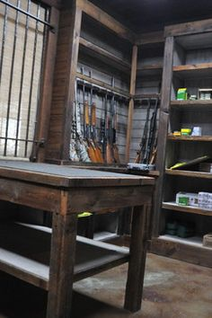 LOVE the look of this with the old wood and painted panels behind. Nice use of shelving for ammo also and a reloading bench.