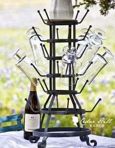French Cup Holder: There are many uses for a cup holder or bottle drying rack. See where I purchased mine and the many ways it can be used to add charm to your table. www.cedarhillfarmhouse.com
