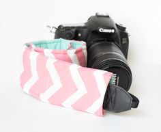 DSLR Camera Strap Cover with lens cap pocket.    Stylish and modern Chevron cover for your SLR or DSLR camera strap!