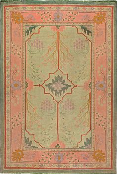 This circa-1920 vintage Arts & Crafts rug by Voysey Rug consists of a geometric medallion outlined in red and surrounded by botanical…