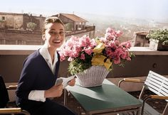 Audrey Hepburn on the terrace of the Hotel Hassler, in Rome, with the telegram announcing her best-actress award