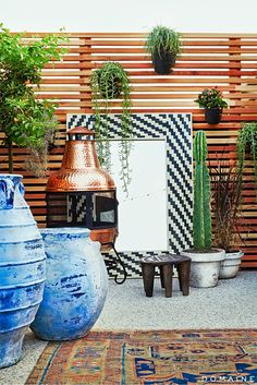 Jen Atkins Rooftop by @consortdesign // Copper standing fireplace, cacti and succulents, and tile accents.