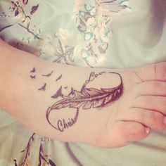 Foot tattoo infinity feather birds love husbands name