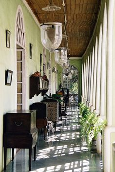 Row of Hundi lantenrs hanging. Serene and green at the Braganza House in Goa